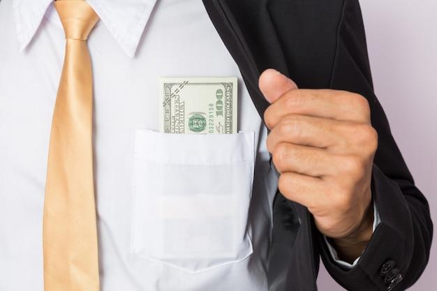 Businessman with money in studio . business concept Premium Photo