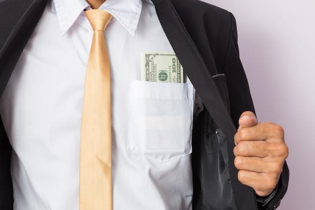 Businessman with money in studio Premium Photo