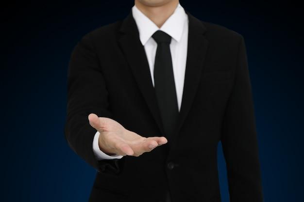 Businessman with open hand gesture presenting blank copyspace Premium Photo
