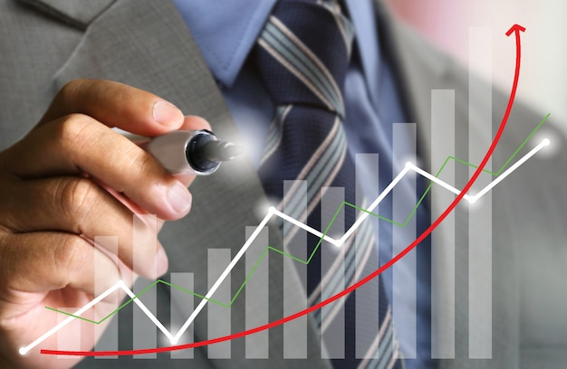 Businessman with suit write stock chart trend up Premium Photo