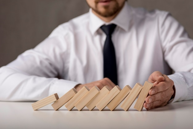 Businessman with tie and dominoes Free Photo