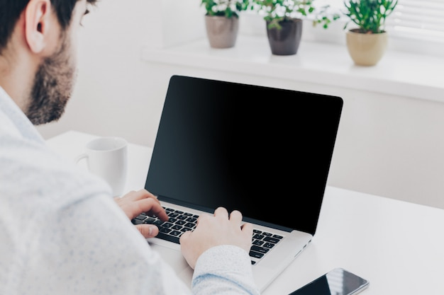Businessman at work, close-up top view of man working on laptop Premium Photo