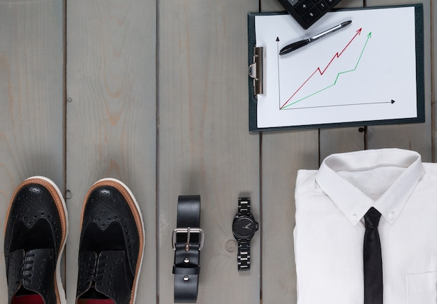 Businessman, work outfit on grey wooden.d calculator. back to work. Premium Photo