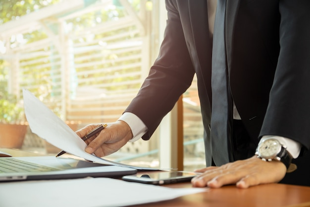 Businessman working at his office with documents paperwork. Premium Photo