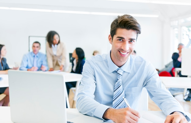 Businessman working in an office and looking at camera Premium Photo