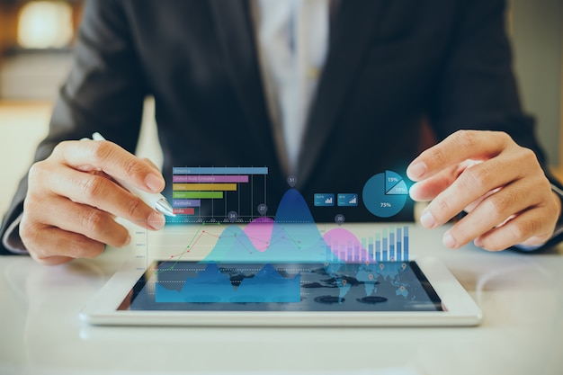 Businessman working on project for swot analyzing company financial report. Premium Photo