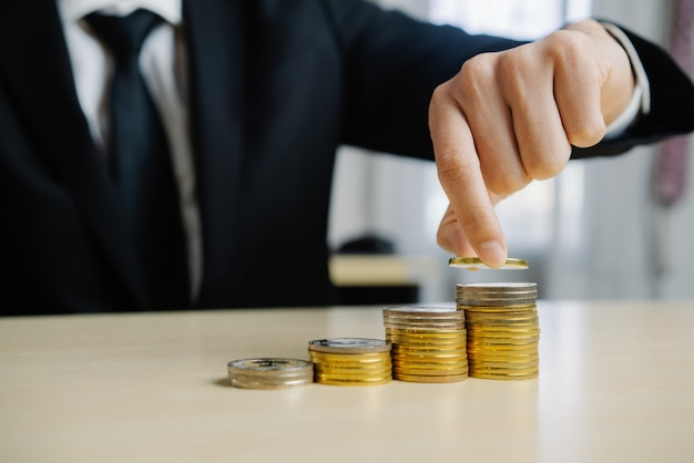 Businessman working with coin money currency. Premium Photo