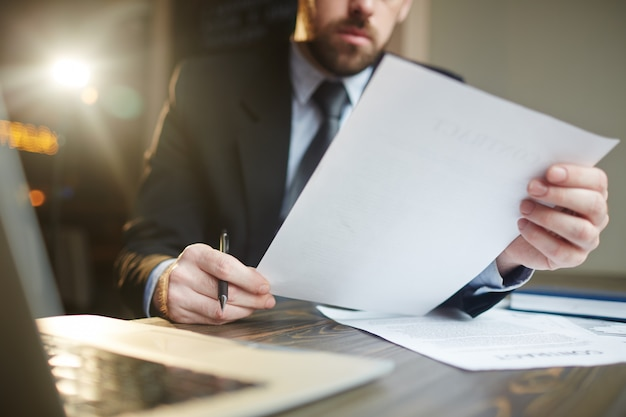 Businessman working with documentation at desk Free Photo