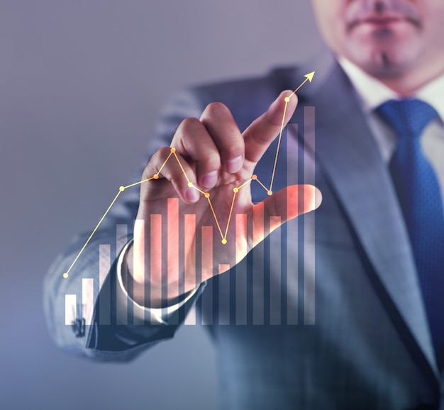 Businessman working with graph in business concept Premium Photo