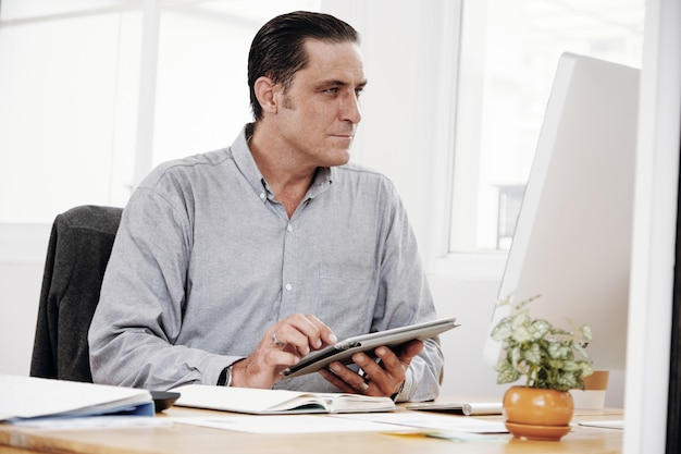 Businessman working with touchpad Free Photo