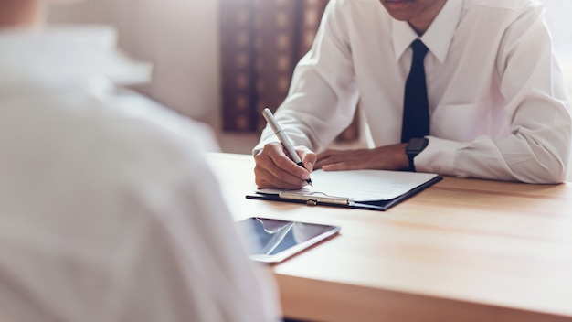 Businessman writing form submit resume employer to review job application. Premium Photo