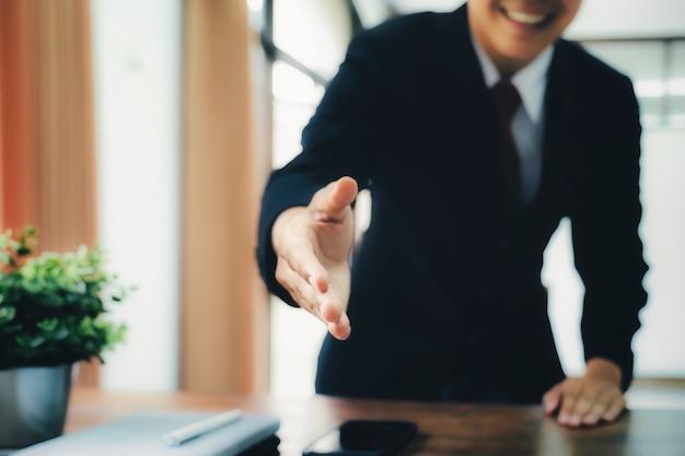 Businessmans handshake after good deal. Premium Photo