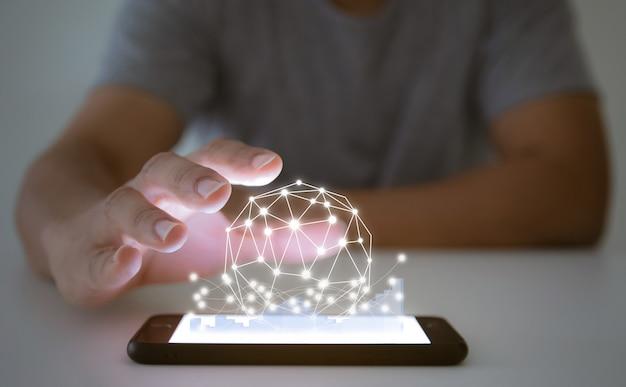 ビジネスマンはスマートフォンとタブレットテクノロジーのソーシャルネットワークの世界でグラフを分析します Premium写真