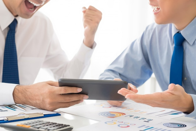 Businessmen excited about statistic results Premium Photo