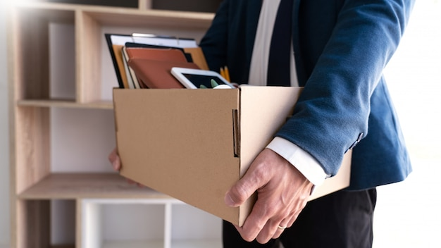 Businessmen keeping his things on a carton box Premium Photo