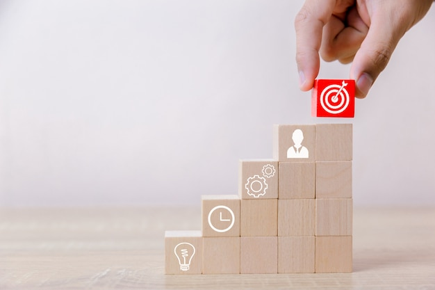 Businessmen laying blocks of wooden steps. service concept of business to success business strategy planning to market victory. Premium Photo
