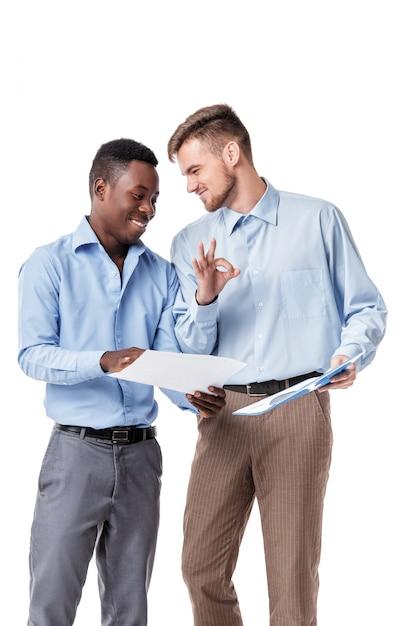 Businessmen looking at documents Premium Photo