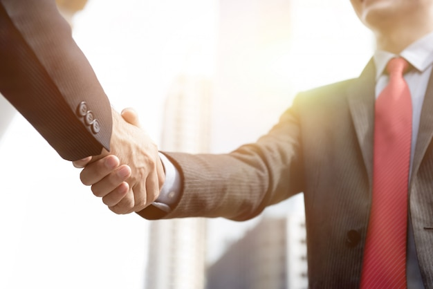 Businessmen making handshake - greeting, dealing, merger and acquisition concepts Premium Photo