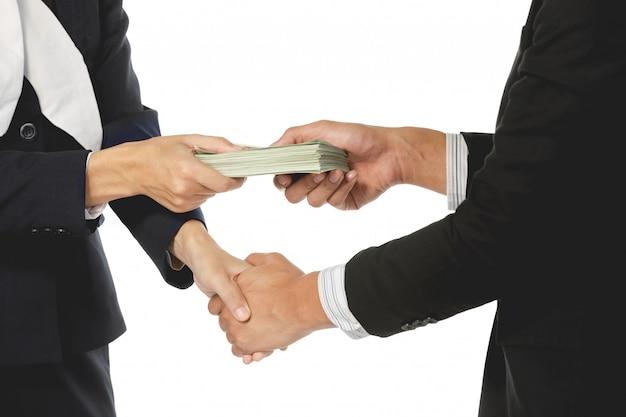 Businessmen making handshake with money in hands Premium Photo
