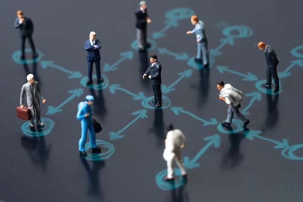 Businessmen miniature keep distance away in the meeting Premium Photo