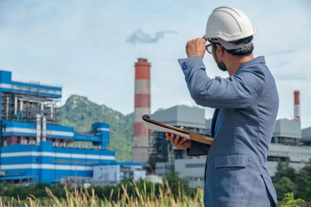 Businessmen at power plant Premium Photo
