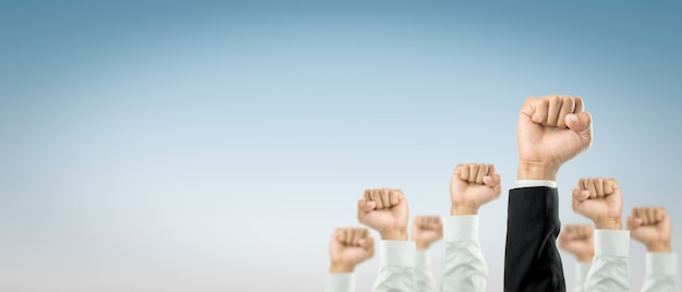 Businessmen raised their hands to win the celebration of the organization.the concept of business is