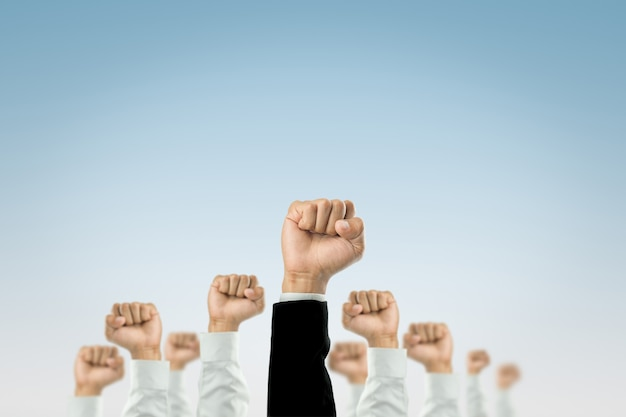 Businessmen raised their hands to win the celebration of the organization. Premium Photo