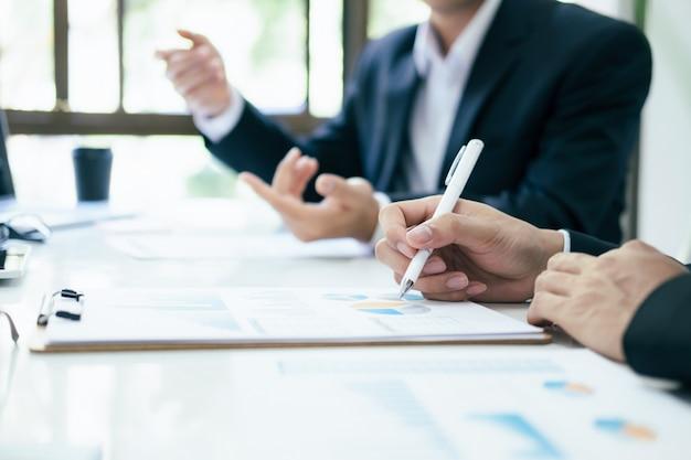 Businessmen teamwork meeting to discuss the investment. Premium Photo
