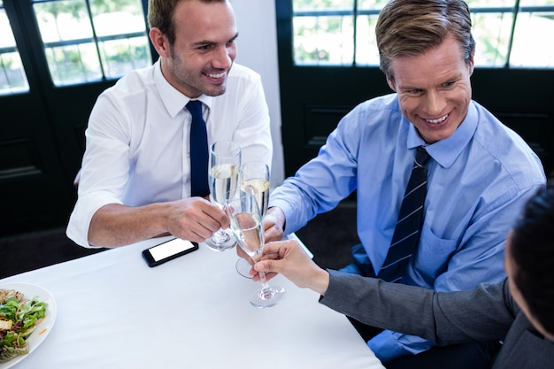 Businessmen toasting with champagne Premium Photo