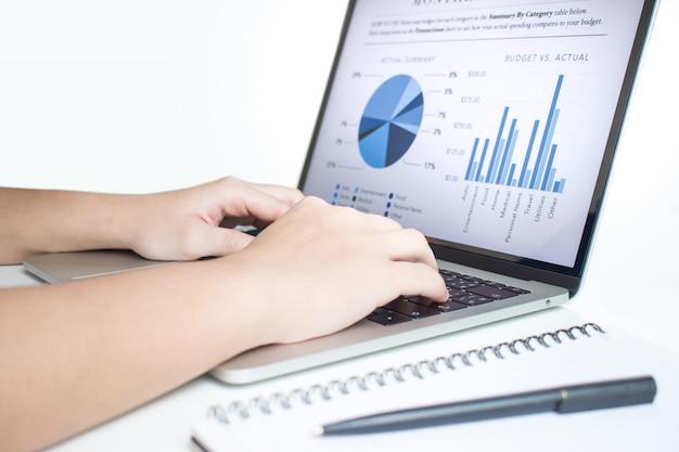 Businessmen use laptops to analyze statistics. Premium Photo