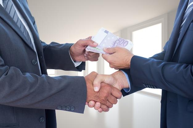 Businessmen with bills Free Photo