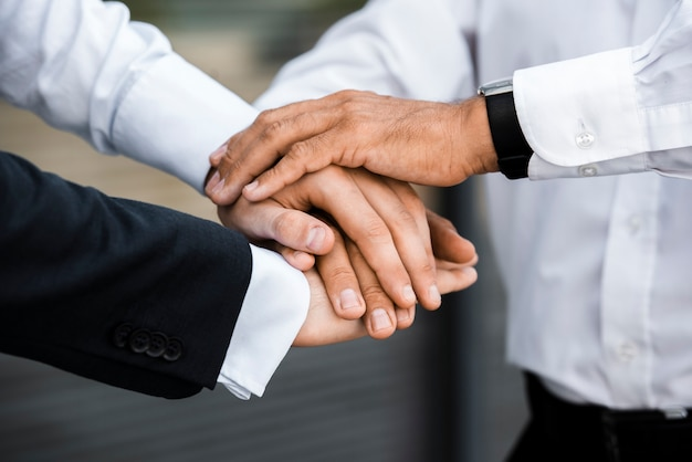 Businessmen with hands together Free Photo