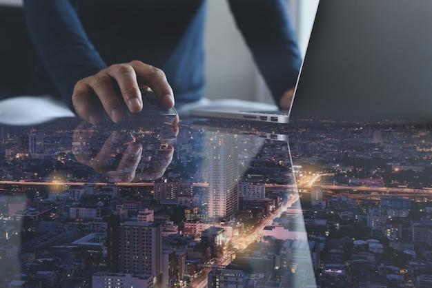 Businessmen working on laptop computer in modern office Premium Photo
