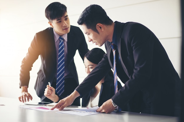 Businessmen working and point on graph financial diagram and analysis documents on office table Premium Photo