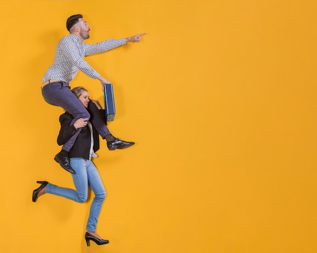 Businesspeople floating with a suitcase Free Photo