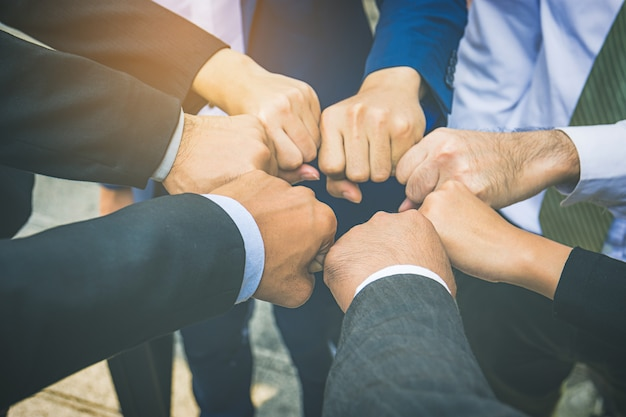 Businesspeople hands in fists in circle, business and teamwork concept Premium Photo