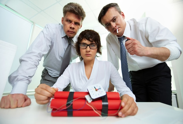 Businesspeople with a time bomb Free Photo