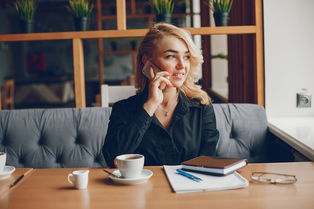 Businesswoman in a caffe Free Photo