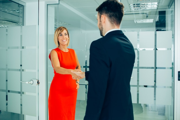 Businesswoman giving a firm handshake Free Photo