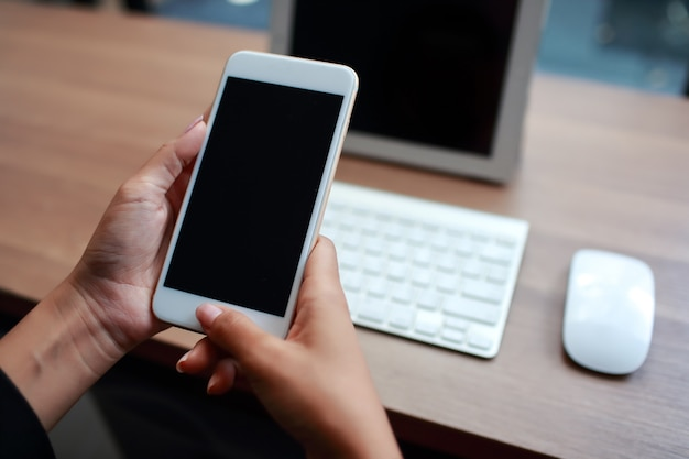 Businesswoman hands using table and cell phone Premium Photo