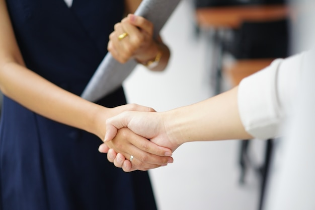 Businesswoman handshake with partner vendor Premium Photo