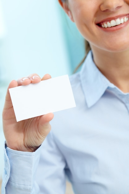 Businesswoman holding a blank business card Free Photo