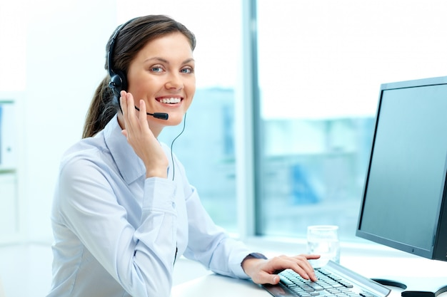 Businesswoman in a call center office Free Photo