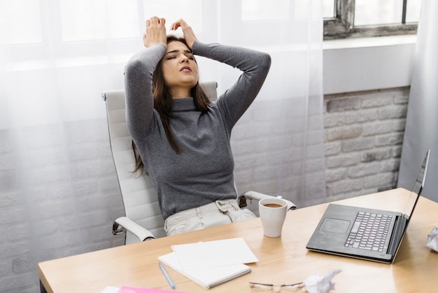 Businesswoman looking frustrated while working from home Free Photo