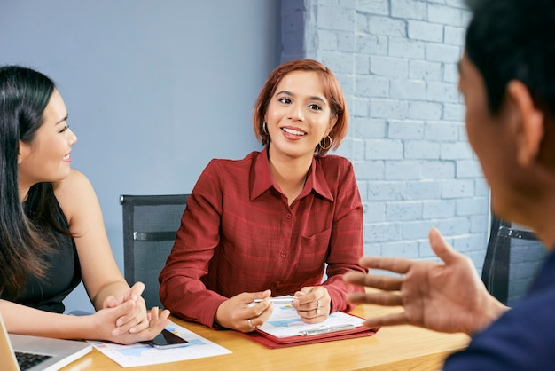 Businesswoman meeting with partners Free Photo