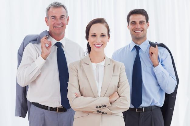 Businesswoman posing with her work team Premium Photo