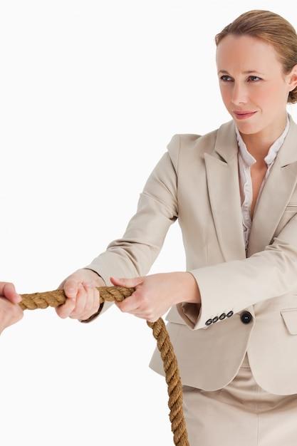 Businesswoman pulling a rope Premium Photo