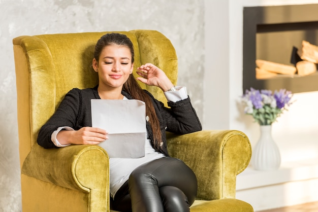 Businesswoman reading document Free Photo