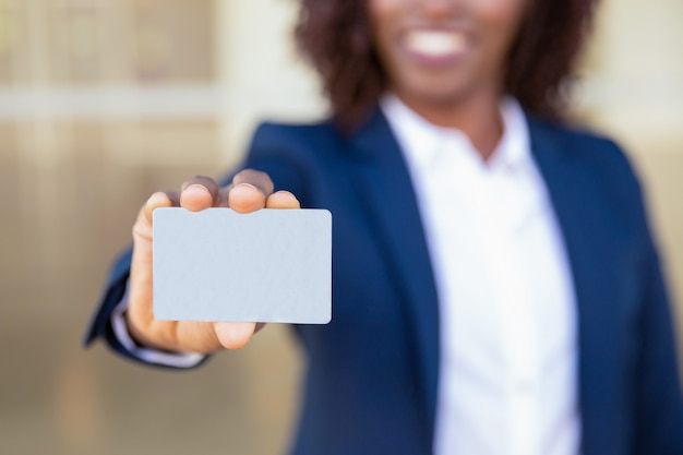 Businesswoman showing credit card Free Photo