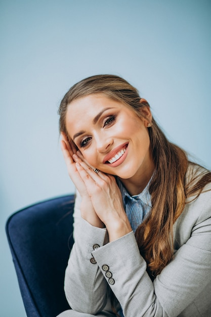 Businesswoman sitting in chair at an office Free Photo